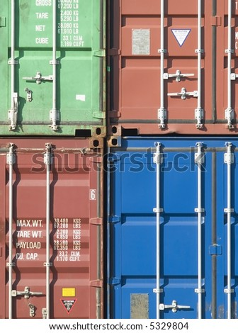 Stack of 40 foot freight containers in assorted colours