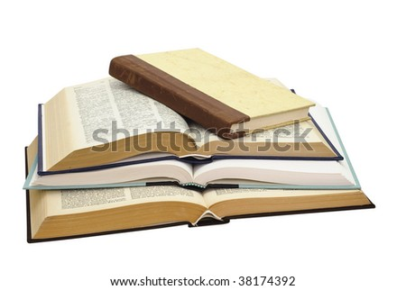 Stack of four books , one closed and three open, on white background, saved with clipping path - stock photo