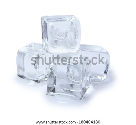 Stack of four ice cubs melting on white background  - stock photo