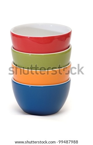 Stack of four porcelain bowls isolated on white background - stock photo