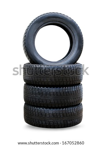 Stack of four wheel new black winter tyres for car - stock photo