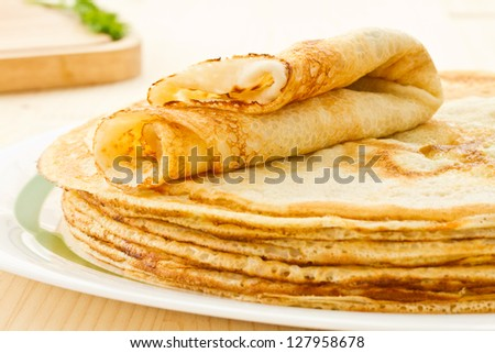 stack of fresh hot pancakes on a plate