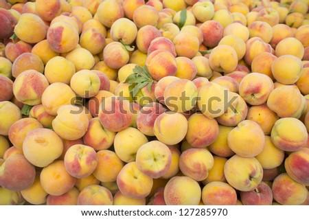 stack of fresh ripe peaches fair - stock photo