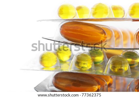 Stack of gel nutritional supplement capsules in blisters on white background. - stock photo