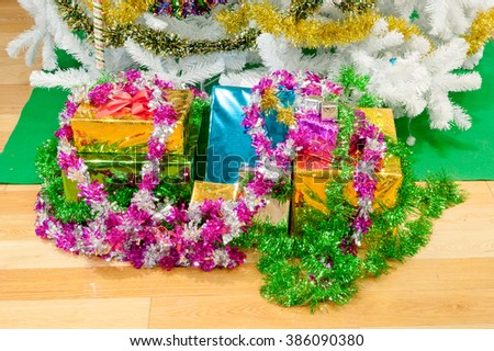Stack of gift box by Christmas tree