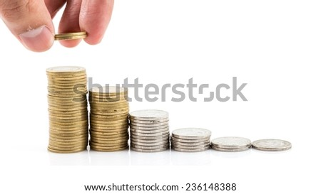 Stack of gold coins and silver coins isolated on a white background.