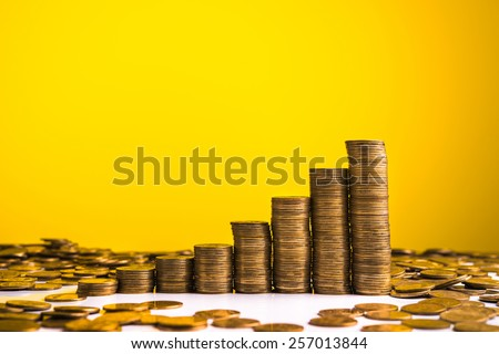 Stack of gold coins on background - stock photo