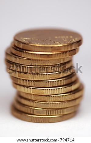Stack of gold tinted coins. Australian 1 dollar coins. White background. - stock photo