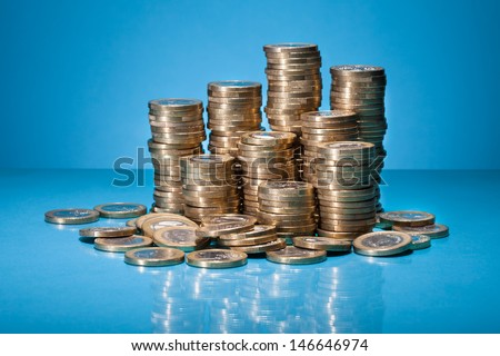 Stack Of Golden Coin Over Blue Background - stock photo