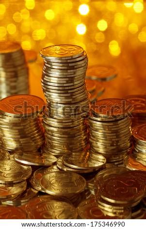 Stack of golden ukrainian coins - stock photo