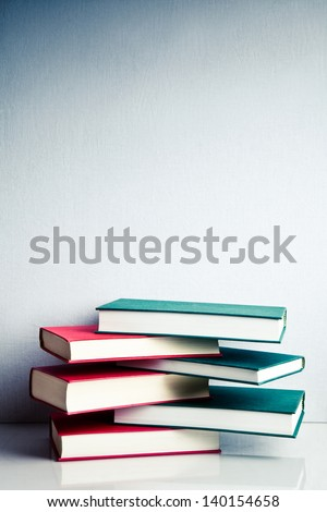 Stack of green and red books in balance