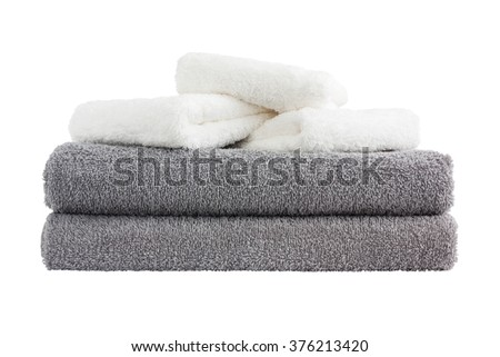 Stack of grey and white bath towels. Isolated over white  - stock photo