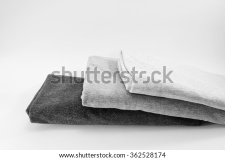 stack of  grey cotton t-shirt on isolate background - stock photo