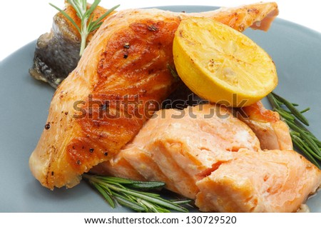 Stack of Grilled Salmon with Rosemary and Lemon closeup on Green Plate - stock photo