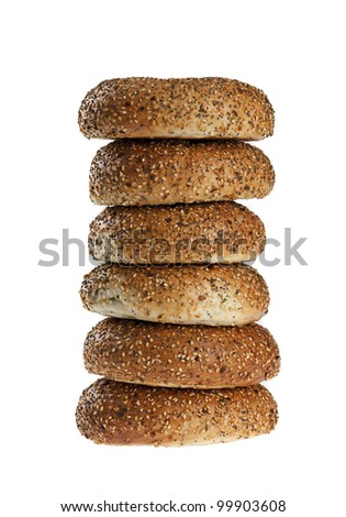 stack of half dozen freshly baked everything bagels isolated on white background