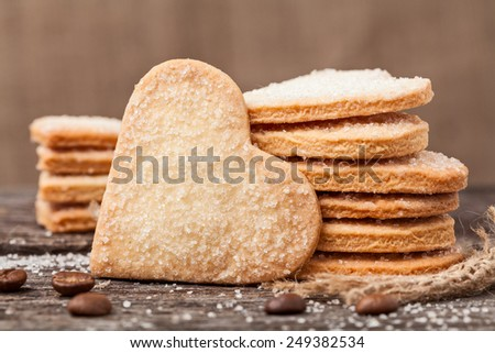 Stack of handmade heart shaped cookies gift for valentines day with love - stock photo