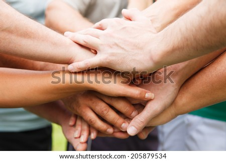 Stack of hands - real people agreement - stock photo