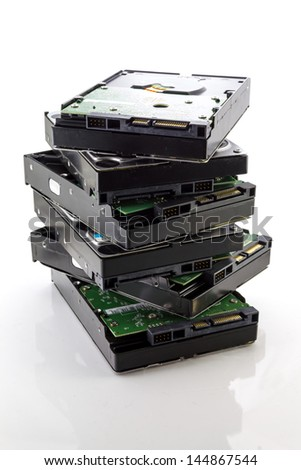 Stack of Hard Disk Drives isolate on white - stock photo