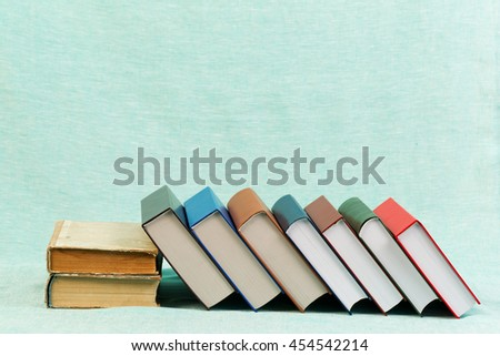 Stack of hardback books on table. Back to school. Copy space. - stock photo