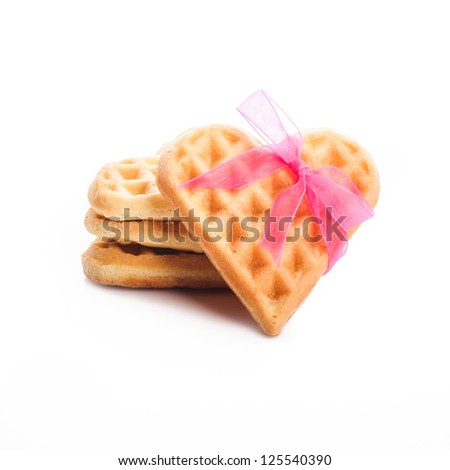 Stack of heart shaped waffles isolated on white background - stock photo