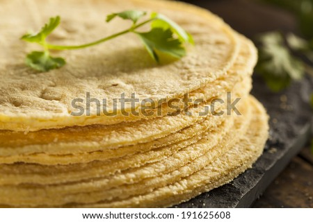 Stack of Homemade Corn Tortillas on a Background - stock photo