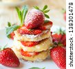 stack of homemade curd pancake with strawberry slices, food closeup - stock photo