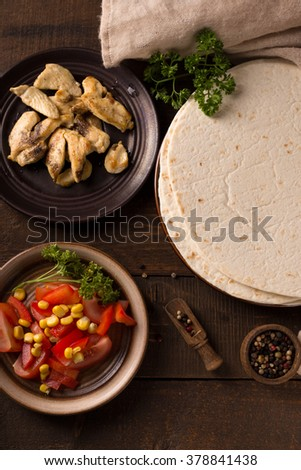 Stack of homemade tortilla on wooden table background