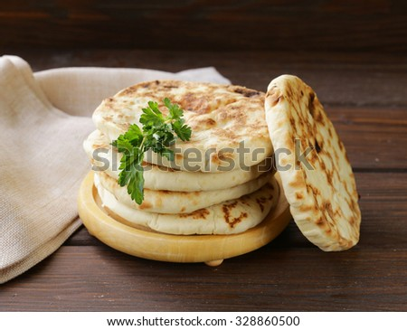 stack of homemade tortillas pita on a wooden table - stock photo