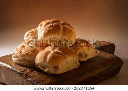 Stack of hot cross buns for Easter with creative lighting - stock photo