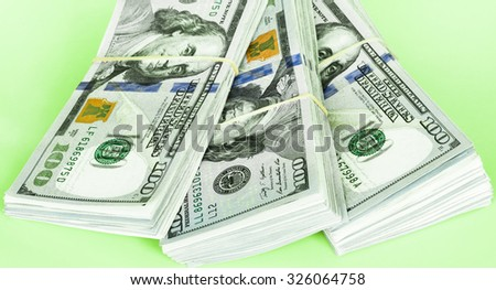Stack of hundred dollars - stock photo
