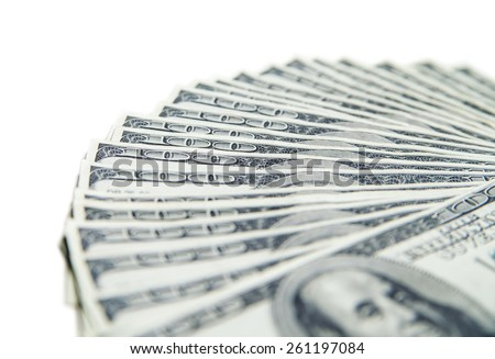 Stack of hundred dollars close-up isolated on white - stock photo