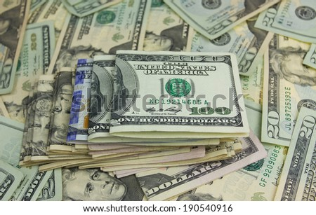 Stack of hundred dollars on money background