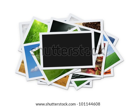 Stack of instant photographs isolated on white background with clipping path for the inside of blank one - stock photo