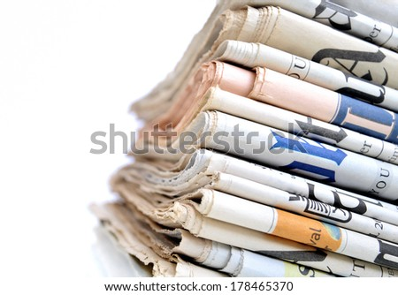 Stack of international newspapers - stock photo