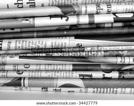 Stack of international newspapers - in black and white - stock photo