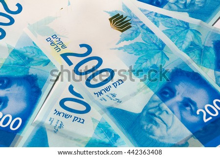 Stack of Israeli money bills of 200 shekel. - stock photo