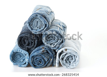 Stack of jeans on white background - stock photo