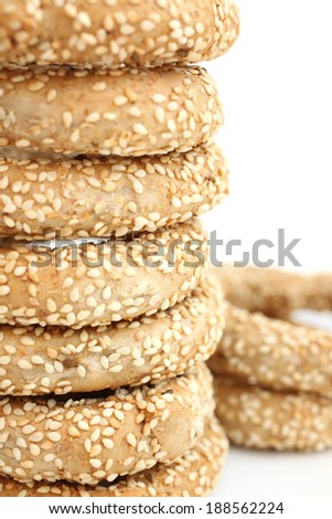 Stack of koulouri - traditional Greek bread on white background