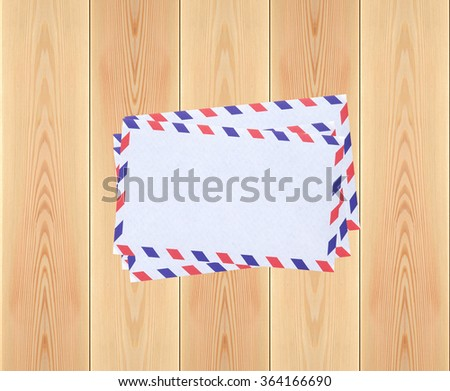 Stack of letters on rustic wooden planks background