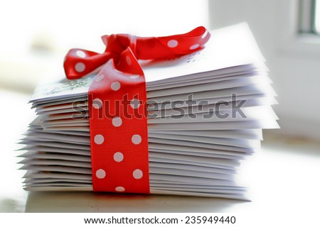 stack of letters with the dot band/ stack of christmas greeting letters - stock photo