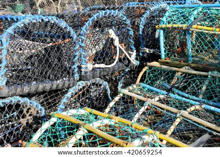 Stack of lobster pots and creels in Scarborough harbor. - stock photo