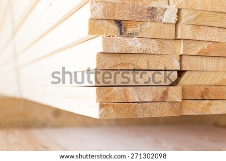 stack of lumber in timber logs storage for construction or industrial work , texture background - stock photo