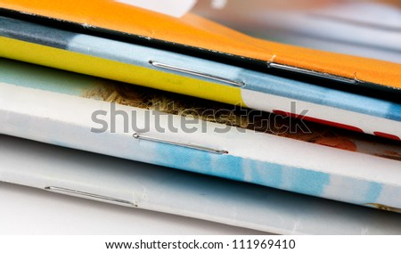 Stack of magazines in a fan viewed from the side - stock photo