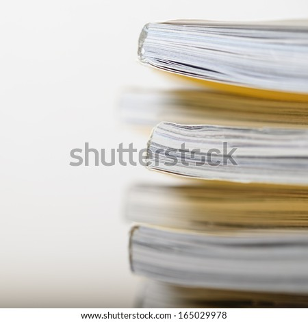 Stack of magazines in very shallow focus - stock photo