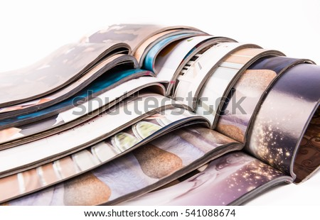 Stack of magazines isolated on white.....