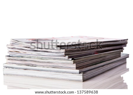Stack of magazines isolated on white background with reflexion