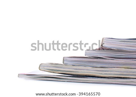 Stack of magazines on a light background