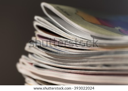 Stack of magazines on black background with swallow depth of field