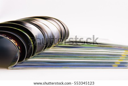 Stack of magazines on white background.
