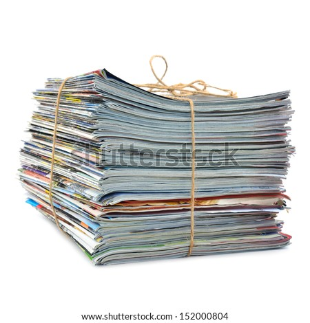 Stack of magazines tied with string - stock photo